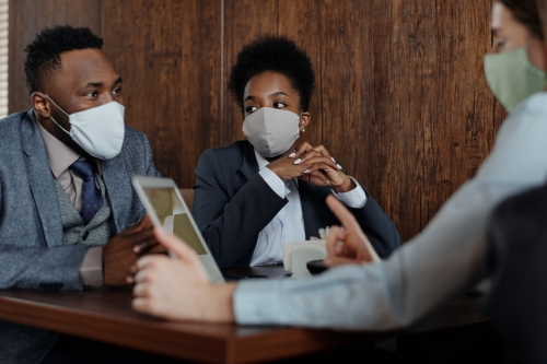 business-people-wearing-face-masks-and-talking-4427957