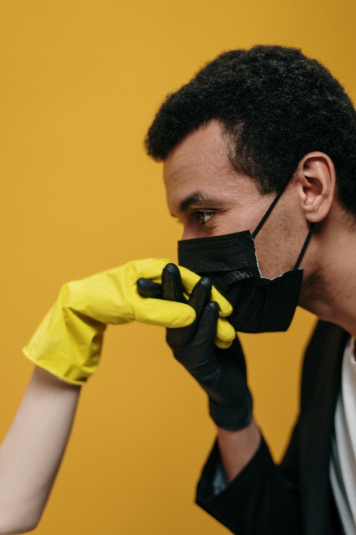 man-in-face-mask-kissing-hand-3951883